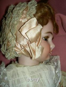 French antique bisque DEP 6 (Jumeau) doll, pierced ears, wood body, signed shoes